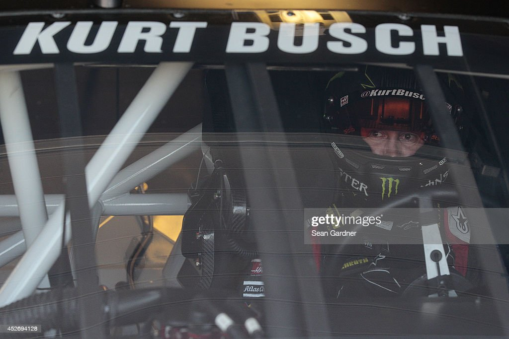 Kurt Busch, driver of the #41 Haas Automation Chevrolet, sits in his car during practice for the NASCAR Sprint Cup Series Quicken Loans 400 at Michigan International Speedway on June 14, 2014 in Brooklyn, Michigan.