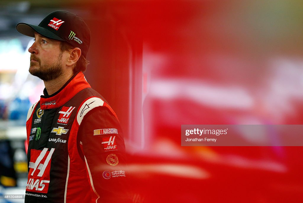 Kurt Busch driver of the Haas Automation Chevrolet stands in the garage area during practice for the NASCAR Sprint Cup Series 5Hour Energy 301 at New...