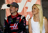 Kurt Busch driver of the Haas Automation Chevrolet stands on pit road with girlfriend Patricia Driscoll after qualifying for the Chase for the Sprint...