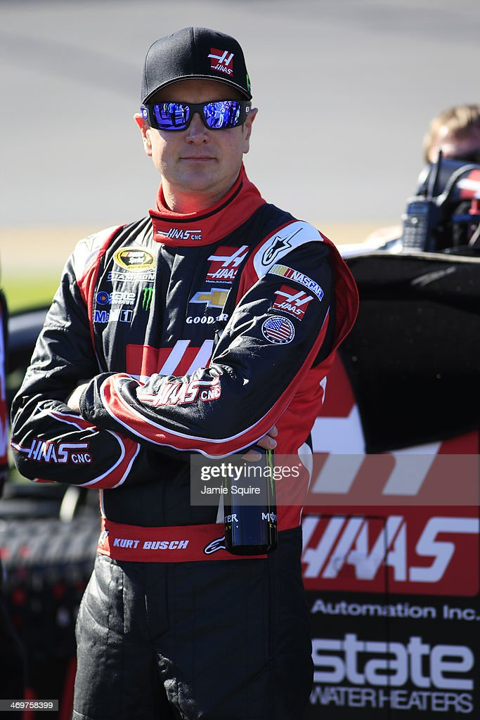 Kurt Busch driver of the Haas Automation Chevrolet stands on the grid during qualifying for the NASCAR Sprint Cup Series Daytona 500 at Daytona...