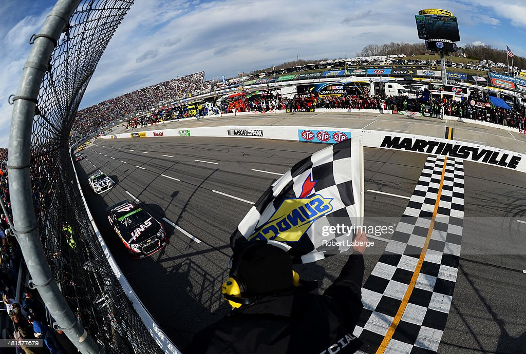 <a gi-track='captionPersonalityLinkClicked' href=/galleries/search?phrase=Kurt+Busch&family=editorial&specificpeople=201728 ng-click='$event.stopPropagation()'>Kurt Busch</a>, driver of the #41 Haas Automation Chevrolet, takes the checkered flag to win the NASCAR Sprint Cup Series STP 500 at Martinsville Speedway on March 30, 2014 in Martinsville, Virginia.