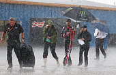 Kurt Busch driver of the Haas Automation Chevrolet walks from pit road during a rain delay at the NASCAR Sprint Cup Series Quicken Loans 400 at...