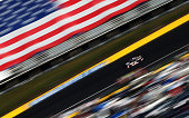 Kurt Busch driver of the Haas Automation Made in America Chevrolet races during the NASCAR Sprint Cup Series CocaCola 600 at Charlotte Motor Speedway...