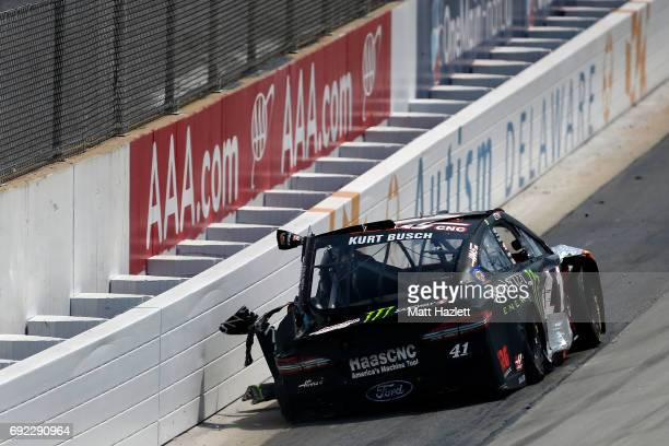 Kurt Busch driver of the Haas Automation/Monster Energy Chevrolet is involved in an ontrack incident during the Monster Energy NASCAR Cup Series AAA...