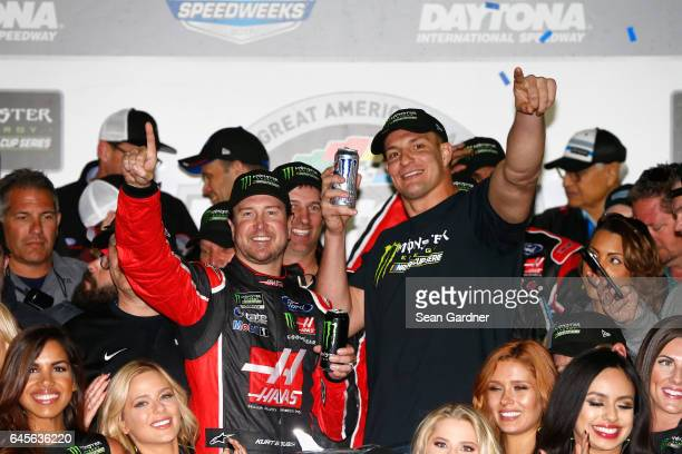 Kurt Busch driver of the Haas Automation/Monster Energy Ford celebrates in Victory Lane with New England Patriots tight end Rob Gronkowski after...