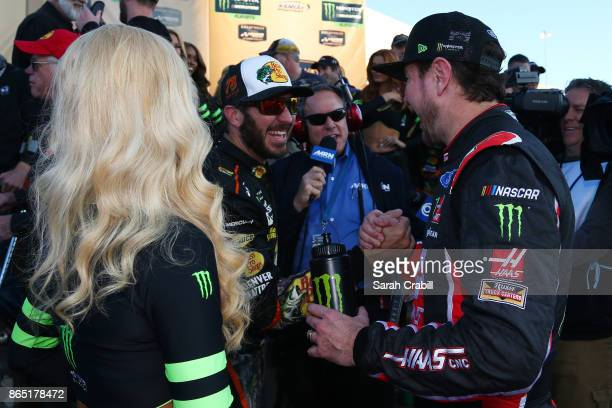 Kurt Busch driver of the Haas Automation/Monster Energy Ford congratulates Martin Truex Jr driver of the Bass Pro Shops/Tracker Boats Toyota in...