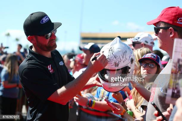 Kurt Busch driver of the Haas Automation/Monster Energy Ford signs autographs prior to the driver's meeting for the Monster Energy NASCAR Cup Series...