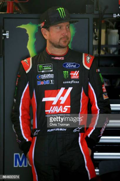 Kurt Busch driver of the Haas Automation/Monster Energy Ford stands in the garage area during practice for the Monster Energy NASCAR Cup Series...