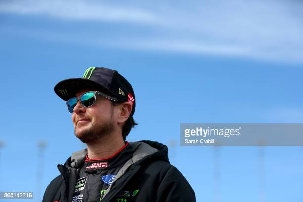 Kurt Busch driver of the Haas Automation/Monster Energy Ford stands on the grid prior to the Monster Energy NASCAR Cup Series Hollywood Casino 400 at...