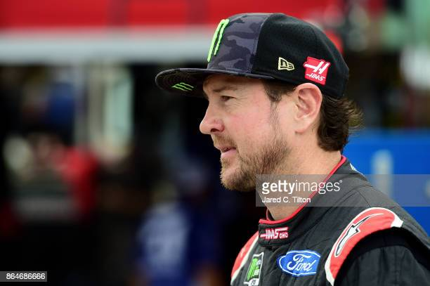 Kurt Busch driver of the Haas Automation/Monster Energy Ford walks to his car during practice for the Monster Energy NASCAR Cup Series Hollywood...