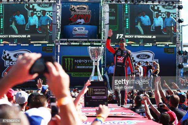 Kurt Busch driver of the Haas Automation/Monster Energy Ford waves to the crowd during introductions prior to the Monster Energy NASCAR Cup Series...