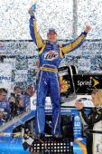 Kurt Busch driver of the Miller Lite Dodge celebrates in Victory Lane after winning the NASCAR Sprint Cup Series Kobalt Tools 500 at Atlanta Motor...