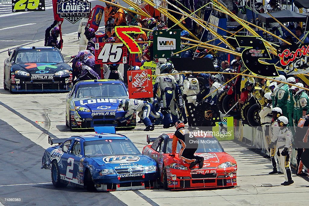 Kurt Busch, driver of the #2 Miller Lite Dodge, drives into <a gi-track='captionPersonalityLinkClicked' href=/galleries/search?phrase=Tony+Stewart+-+Piloto+de+automobilismo&family=editorial&specificpeople=201686 ng-click='$event.stopPropagation()'>Tony Stewart</a>, driver of the #20 Home Depot Chevrolet, in pit row after the two crashed into each other during the NASCAR Nextel Cup Series Autism Speaks 400 on June 4, 2007 at Dover Downs International Speedway in Dover, Delaware.