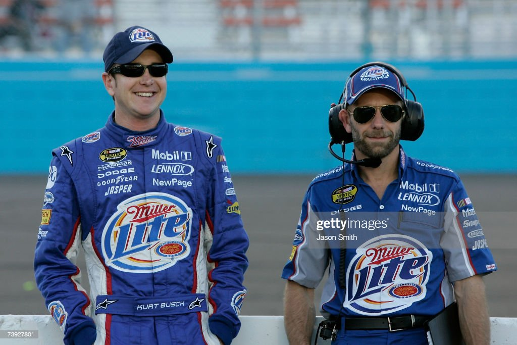 Kurt Busch driver of the Miller Lite Dodge stands with interim crew chief Troy Raker on pit road during qualifying for the NASCAR Nextel Cup Series...