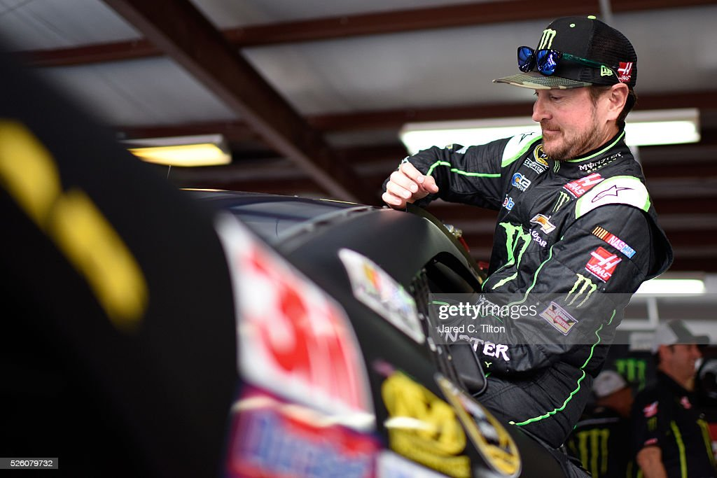 <a gi-track='captionPersonalityLinkClicked' href=/galleries/search?phrase=Kurt+Busch&family=editorial&specificpeople=201728 ng-click='$event.stopPropagation()'>Kurt Busch</a>, driver of the #41 Monster Energy Chevrolet, climbs into his car during practice for the NASCAR Sprint Cup Series GEICO 500 at Talladega Superspeedway on April 29, 2016 in Talladega, Alabama.