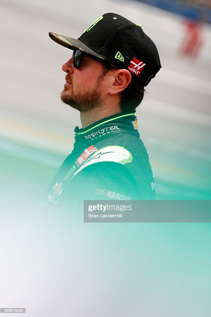 <a gi-track='captionPersonalityLinkClicked' href=/galleries/search?phrase=Kurt+Busch&family=editorial&specificpeople=201728 ng-click='$event.stopPropagation()'>Kurt Busch</a>, driver of the #41 Monster Energy Chevrolet, stands on the grid during qualifying for the NASCAR Sprint Cup Series GEICO 500 at Talladega Superspeedway on April 30, 2016 in Talladega, Alabama.