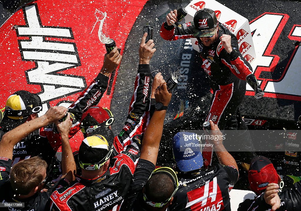 Kurt Busch driver of the Monster Energy/Haas Automation Chevrolet celebrates in Victory Lane after winning the NASCAR Sprint Cup Series Axalta 'We...