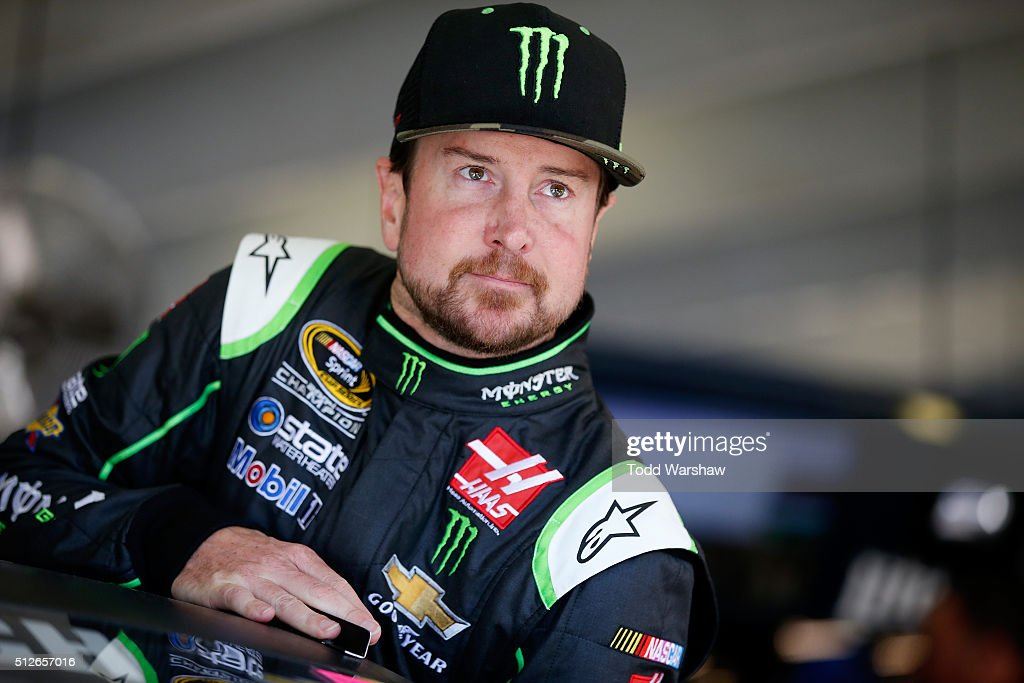 Kurt Busch driver of the Monster Energy/Haas Automation Chevrolet looks on from the garage area during practice for the NASCAR Sprint Cup Series...