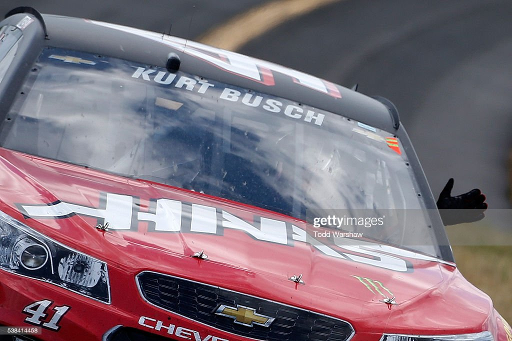 Kurt Busch driver of the Monster Energy/Haas Automation Chevrolet celebrates after winning the NASCAR Sprint Cup Series Axalta 'We Paint Winners' 400...