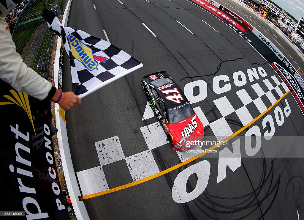 Kurt Busch driver of the Monster Energy/Haas Automation Chevrolet takes the checkered flag to win the NASCAR Sprint Cup Series Axalta 'We Paint...