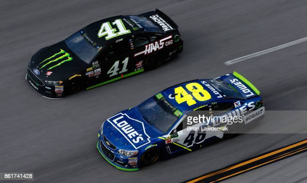 Kurt Busch driver of the Monster Energy/Haas Automation Ford and Jimmie Johnson driver of the Lowe's Chevrolet race during the Monster Energy NASCAR...