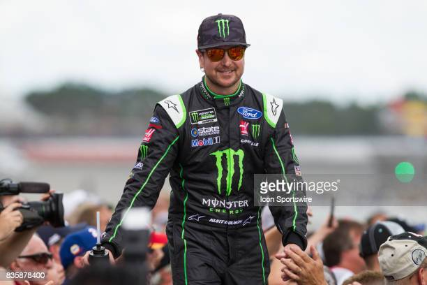 Kurt Busch driver of the Monster Energy/Haas Automation Ford greets fans during the prerace ceremonies of the Monster Energy NASCAR Cup Series Pure...