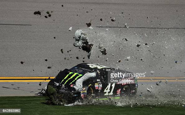 Kurt Busch driver of the Monster Energy/Haas Automation Ford is involved in an ontrack incident during the weather delayed Monster Energy NASCAR Cup...