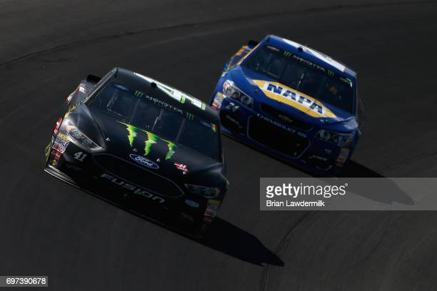 Kurt Busch driver of the Monster Energy/Haas Automation Ford leads Chase Elliott driver of the NAPA Chevrolet during the Monster Energy NASCAR Cup...