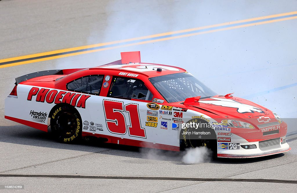 <a gi-track='captionPersonalityLinkClicked' href=/galleries/search?phrase=Kurt+Busch&family=editorial&specificpeople=201728 ng-click='$event.stopPropagation()'>Kurt Busch</a>, driver of the #51 Phoenix Construction Chevrolet, spins out after an incident in the NASCAR Sprint Cup Series Good Sam Roadside Assistance 500 at Talladega Superspeedway on October 7, 2012 in Talladega, Alabama.