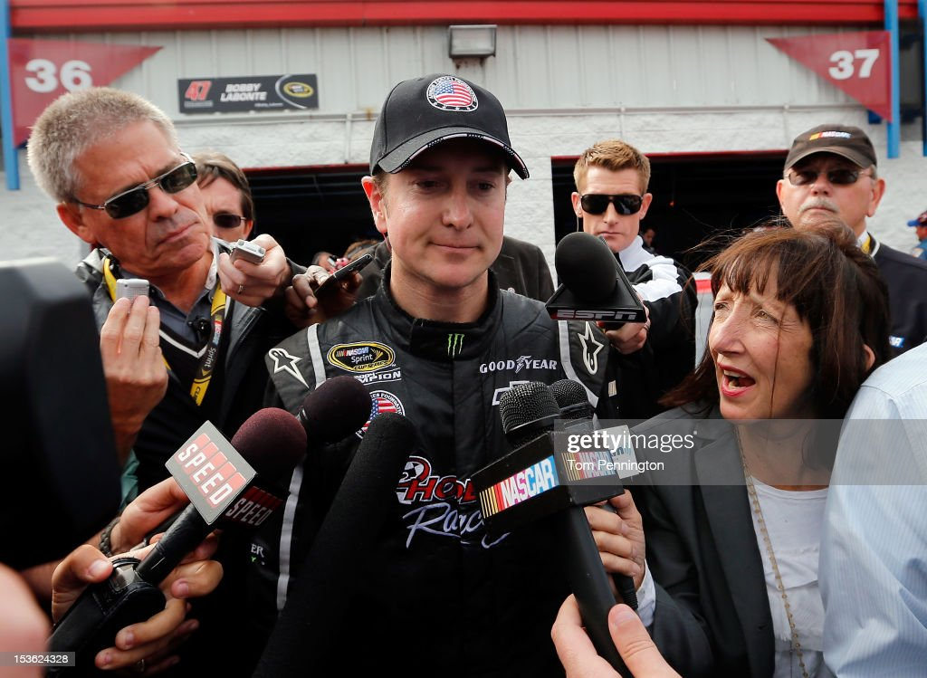 <a gi-track='captionPersonalityLinkClicked' href=/galleries/search?phrase=Kurt+Busch&family=editorial&specificpeople=201728 ng-click='$event.stopPropagation()'>Kurt Busch</a>, driver of the #51 Phoenix Construction Chevrolet, talks to the media after an incident during the NASCAR Sprint Cup Series Good Sam Roadside Assistance 500 at Talladega Superspeedway on October 7, 2012 in Talladega, Alabama.