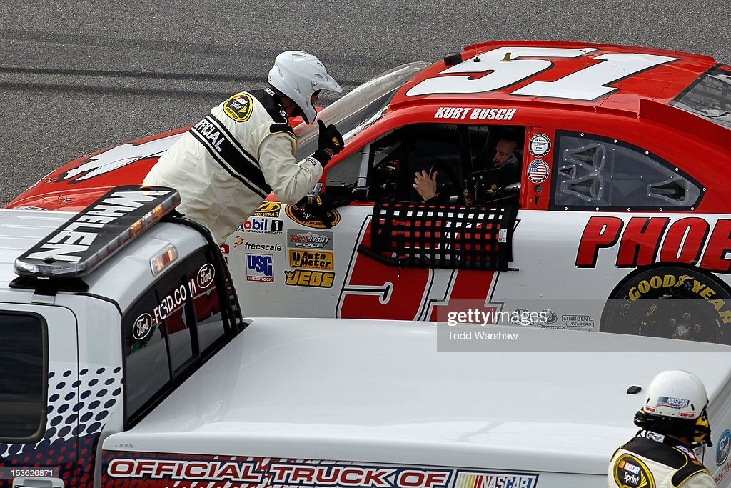 <a gi-track='captionPersonalityLinkClicked' href=/galleries/search?phrase=Kurt+Busch&family=editorial&specificpeople=201728 ng-click='$event.stopPropagation()'>Kurt Busch</a>, driver of the #51 Phoenix Construction Chevrolet, talks with NASCAR Officials after an incident in the NASCAR Sprint Cup Series Good Sam Roadside Assistance 500 at Talladega Superspeedway on October 7, 2012 in Talladega, Alabama.