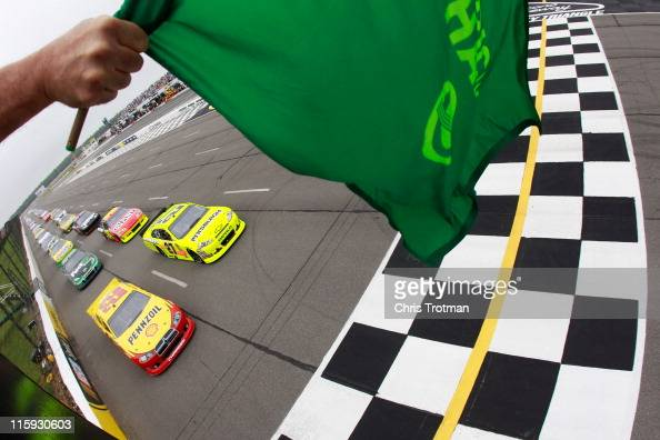 Kurt Busch driver of the Shell/Pennzoil Dodge and Paul Menard driver of the Pittsburgh Paints/Menards Chevrolet lead the field past the green flag to...