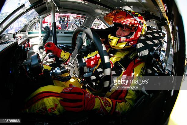 Kurt Busch driver of the Shell/Pennzoil Dodge sits in his car during practice for the NASCAR Sprint Cup Series Hollywood Casino 400 at Kansas...