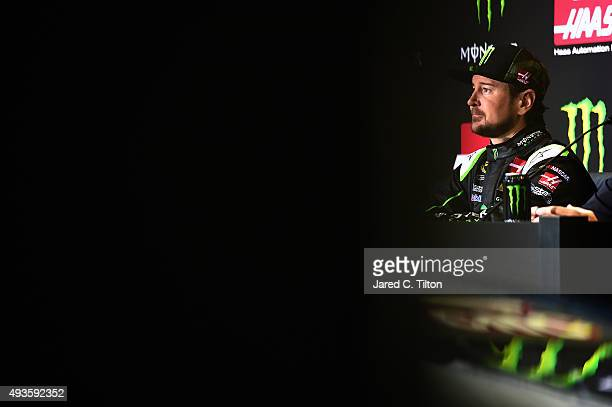 Kurt Busch driver of the StewartHaas Racing Chevrolet answers looks on during a press conference announcing Monster Energy as a cosponsor on the...
