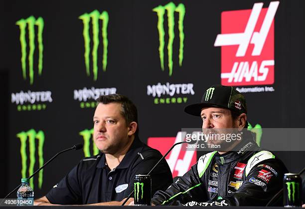 Kurt Busch driver of the StewartHaas Racing Chevrolet speaks with the media as Tony Stewart coowner of StewartHaas Racing looks on during a press...