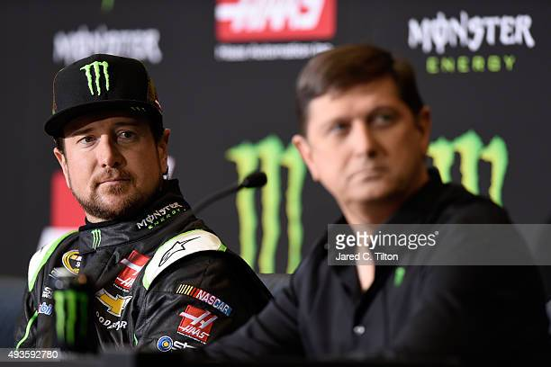 Kurt Busch driver of the StewrtHaas Chevrolet and Mitch Covington vice president of sports marketing Monster Energy look on during a press conference...