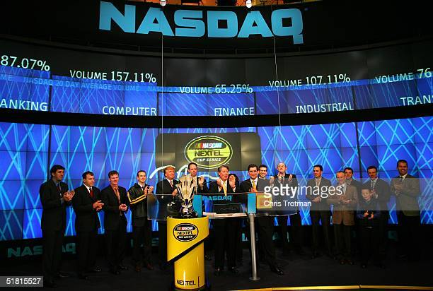 Kurt Busch the 2004 NASCAR NEXTEL Cup Series Champion with Donald Trump and NEXTEL Cup Series Top Ten and NEXTELS Tim Donahue open the NASDAQ...