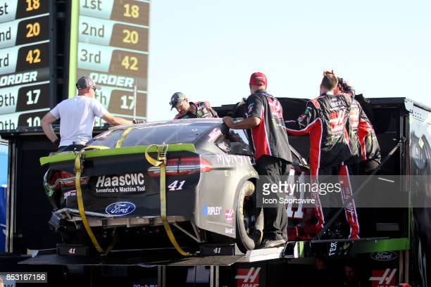 Kurt Busch's crew loads his wrecked race car into the hauler during the Monster Energy NASCAR Cup Series ISM Connect 300 race on September 24 at New...