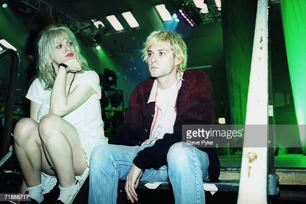 Kurt Cobain lead singer of American grunge band Nirvana backstage with his wife Courtney Love singer with the band Hole early 1990s