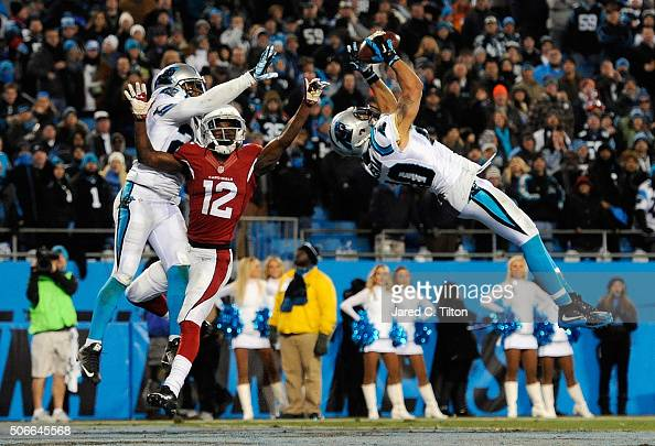 Kurt Coleman of the Carolina Panthers intercepts a pass intended for John Brown of the Arizona Cardinals at the end of the first half during the NFC...