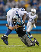 Kurt Coleman of the Carolina Panthers tackles Frank Gore of the Indianapolis Colts during their game at Bank of America Stadium on November 2 2015 in...