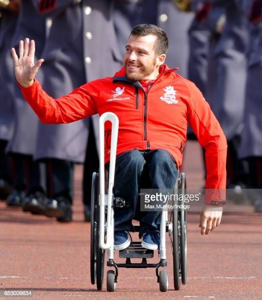 Kurt Fearnley carries The Queen's Baton down The Mall as he attends the launch of The Queen's Baton Relay for the XXI Commonwealth Games being held...
