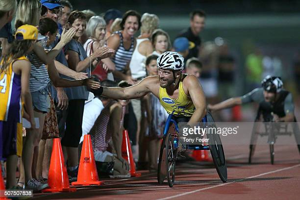 Kurt Fearnley greets the crowd after winning the Mens 1500m wheelchair during the 2016 Hunter Track Classic on January 30 2016 in Newcastle Australia