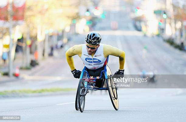 Kurt Fearnley leads other competitors up William Street during the start of the 2016 City to Surf on August 14 2016 in Sydney Australia