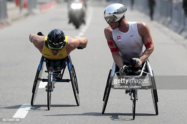 Kurt Fearnley of Australia and Marcel Hug of Switzerland competes in the Men's Marathon T54 at Fort Copacabana on day 11 of the Rio 2016 Paralympic...