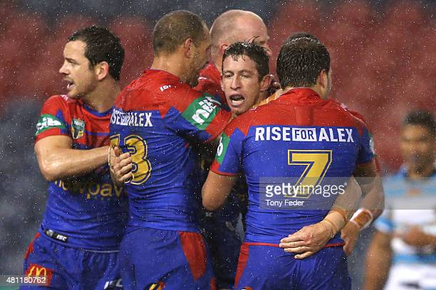 Kurt Gidley of the Knights celebrates with team mates after scoring a try during the round 19 NRL match between the Newcastle Knights and the Gold...