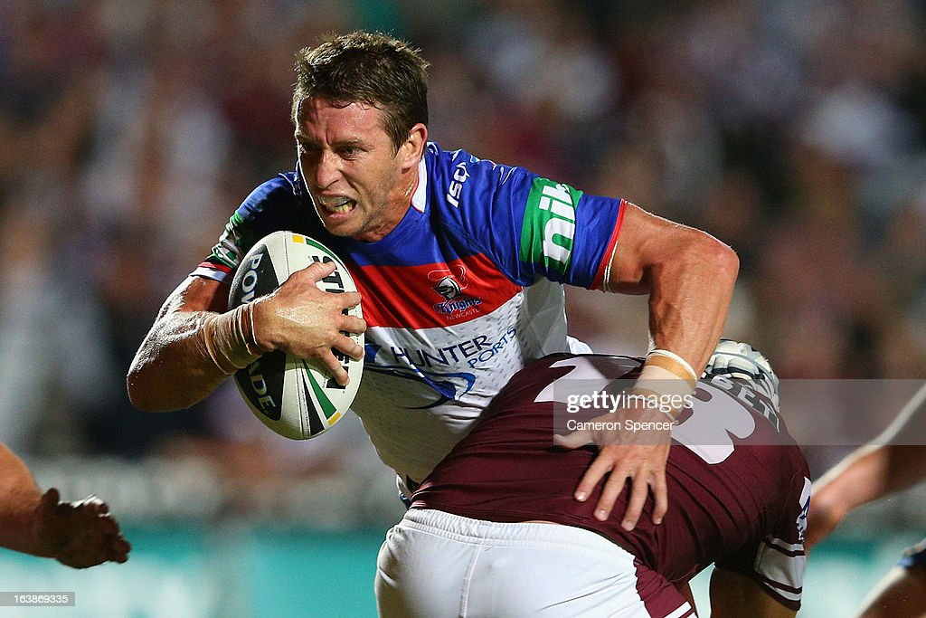<a gi-track='captionPersonalityLinkClicked' href=/galleries/search?phrase=Kurt+Gidley&family=editorial&specificpeople=221401 ng-click='$event.stopPropagation()'>Kurt Gidley</a> of the Knights is tackled during the round two NRL match between the Manly Sea Eagles and the Newcastle Knights at Brookvale Oval on March 17, 2013 in Sydney, Australia.