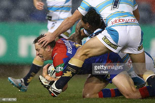 Kurt Gidley of the Knights scores a try during the round 19 NRL match between the Newcastle Knights and the Gold Coast Titans at Hunter Stadium on...
