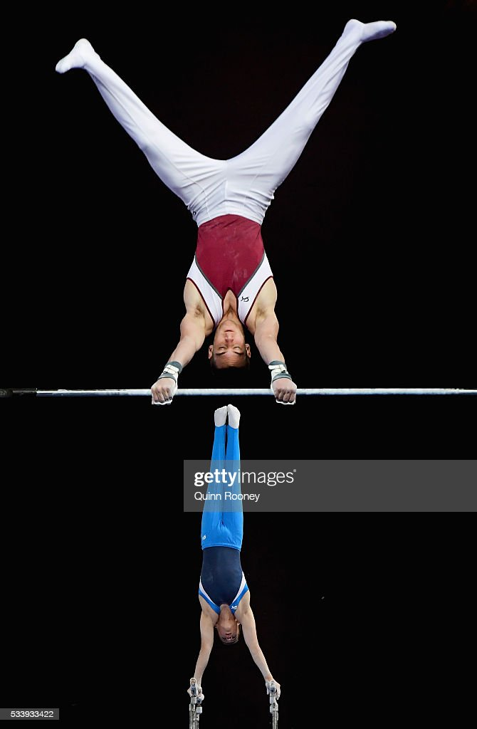 Kurt Grumelart of Queensland competes on the high bar as Alexander Waro of New South Wales competes on the parrallel bars during the 2016 Australian Gymnastics Championships at Hisense Arena on May 23, 2016 in Melbourne, Australia.