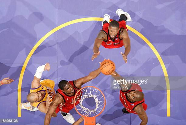 Kurt Looby Trent Strickland and Jawad Williams of the Rio Grande Valley Vipers reach for a rebound against Craig Winder of the Los Angele DFenders...